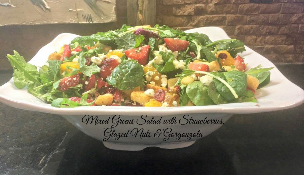 mixed greens salad with strawberries, glazed nuts & gorgonzola